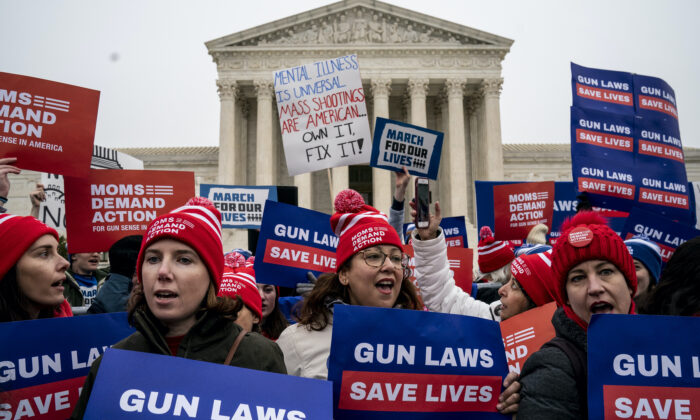 Gun safety advocates rally in front of the U.S. Supreme Court during oral arguments in the Second Amendment case NY State Rifle & Pistol vs. City of New York, N.Y., in Washington, on Dec. 2, 2019. (Drew Angerer/Getty Images)