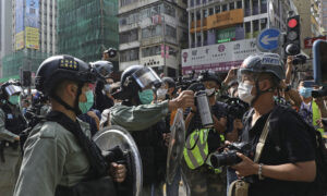 Photojournalist Risks His Life in Hong Kong
