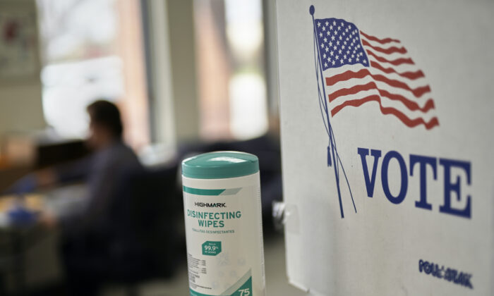Disinfecting wipes stand at the ready at the Lancaster County Election Committee offices in Lincoln, Neb., on April 14, 2020. (Nati Harnik/AP photo)