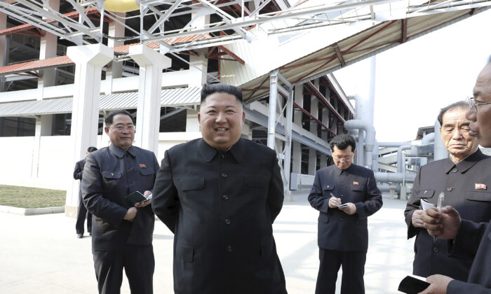 North Korean leader Kim Jong Un (C) visits a fertilizer factory in Sunchon, South Pyongan province, near Pyongyang, North Korea, in this May 1, 2020, photo provided by the North Korean regime. (Korean Central News Agency/Korea News Service via AP)