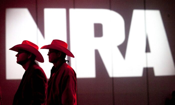 National Rifle Association members listen to speakers during the NRA's annual Meetings and Exhibits at the George R. Brown Convention Center in Houston, Texas, on May 4, 2013. (Johnny Hanson/Houston Chronicle via AP)