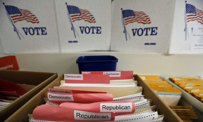 Ballots for the primary elections are arranged by party affiliation at the Lancaster County Election Committee offices in Lincoln, Neb., on April 14, 2020. (Nati Harnik/AP photo)