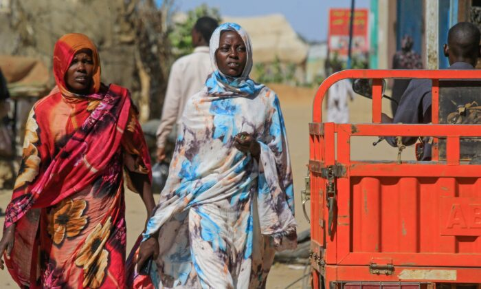 Sudanese women walk to a market in Abu Shouk camp, nearly 20 kms north of El-Fasher, the capital of the North Darfur state, on Nov. 5, 2019. (Ashraf Shazly/AFP via Getty Images)