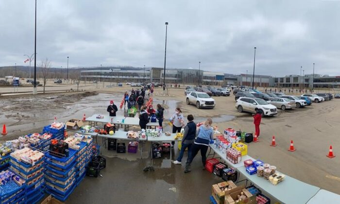 Photo shows the donated food in Fort McMurray after the flood. The Regional Municipality of Wood Buffalo lifted a mandatory evacuation order for five parts of the city late Friday, May 1, 2020, citing receding water levels. An ice jam earlier this week on the Athabasca River led to the flooding of the city's downtown, forcing close to 13,000 people out of their homes. (The Canadian Press)
