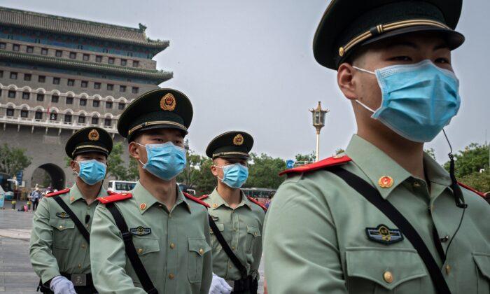Paramilitary police officers patrol near Beijing's Tiananmen Square