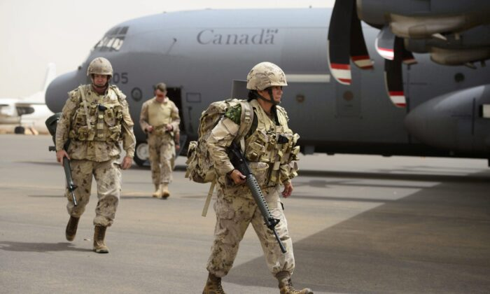 Canadian troops arrive at a U.N. base in Gao, Mali, on June 25, 2018. Deploying troops to conflict areas is part of Canada's foreign aid program. (Sean Kilpatrick/The Canadian Press)