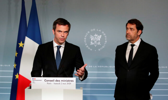 French Minister for Solidarity and Health Olivier Véran, and French Interior Minister Christophe Castaner attend a news conference after a cabinet meeting, as the spread of COVID-19 continues, at the Elysee Palace in Paris on May 2, 2020. (Francois Mori/Pool via Reuters)