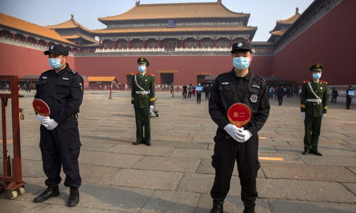 Chinese paramilitary police and security officers stand guard outside an entrance to the Forbidden City in Beijing on May 1, 2020. (Mark Schiefelbein/AP Photo)