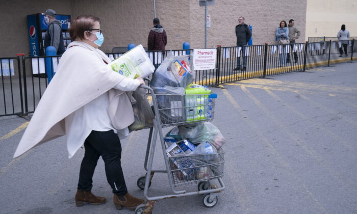 A woman walks away from a variety store in St-Jean-sur-Richelieu, Que. on May 4, 2020. Retail stores outside the greater Montreal area have been allowed to reopen after weeks of forced closure due to the COVID-19 pandemic.  (Paul Chiasson/The Canadian Press)