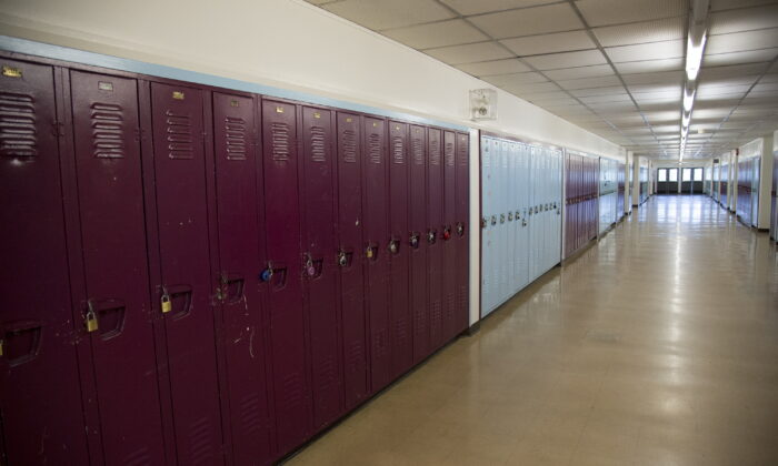A empty hallway is pictured at Eric Hamber Secondary school in Vancouver, B.C., on March 23, 2020. (Jonathan Hayward/The Canadian Press)