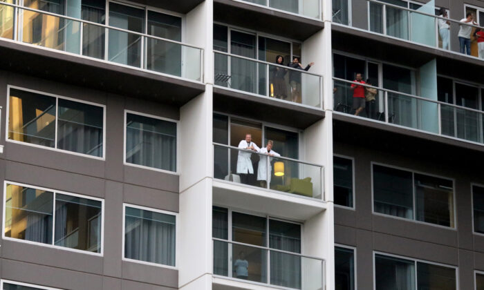 Guests on the balconies of the Pullman watching Adelaide cabaret performer Hans performs in Adelaide, Australia, on May 3, 2020. (Kelly Barnes/Getty Images)
