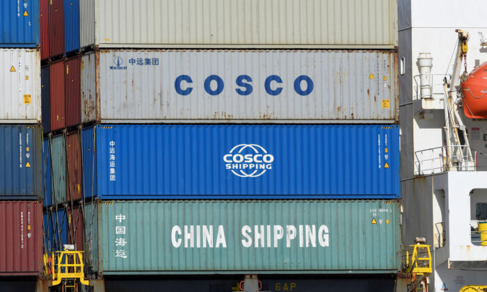 Containers of Chinese companies China Shipping and COSCO (China Ocean Shipping Company) are loaded on a container as it's leaving the port in Hamburg, Germany, on March 11, 2020. (Fabian Bimmer/File Photo/Reuters)
