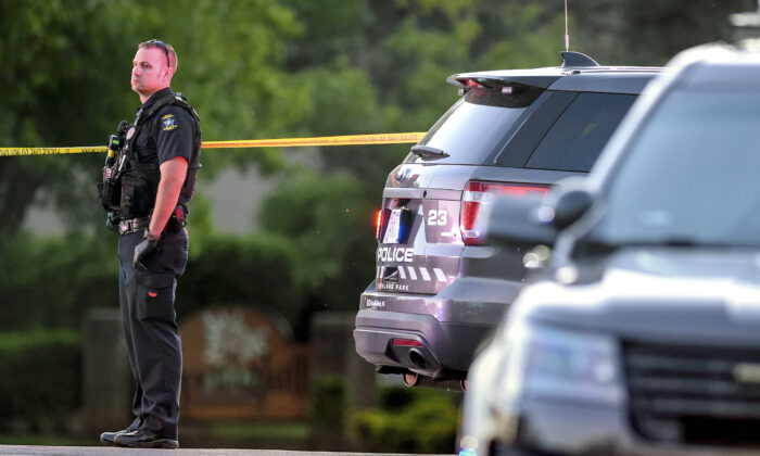 A policeman looks over the scene where police in Kansas say a shootout has left both a police officer and a hit-and-run suspect dead, in Overland Park, Kan., on May 3, 2020. (Tammy Ljungblad/The Kansas City Star via AP)