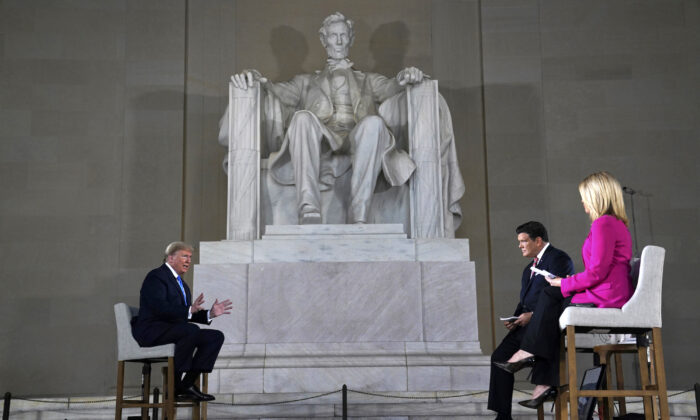 President Donald Trump speaks during a Fox News virtual town hall from the Lincoln Memorial, in Washington, on May 3, 2020. (AP Photo/Evan Vucci)