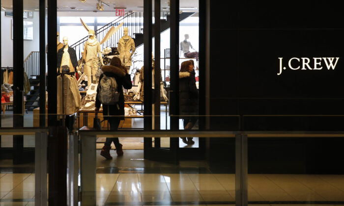 A customer walks into a clothing retailer J. Crew store in Manhattan on March 3, 2014. (Mike Segar/File Photo/Reuters)
