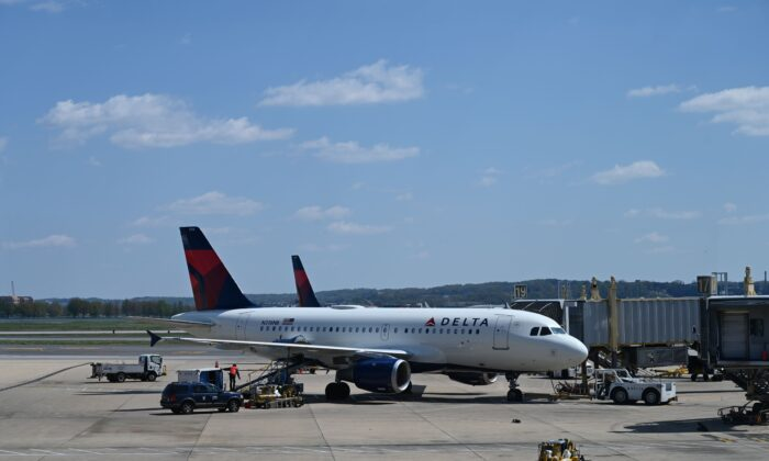 A Delta Airlines airplane is seen at gate at Washington National Airport (DCA) on April 11, 2020 in Arlington, Va. (Daniel Slim/AFP via Getty Images)