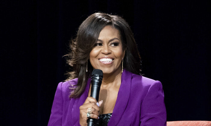 """Former first lady Michelle Obama during """"Becoming: An Intimate Conversation with Michelle Obama,"""" in Atlanta on May 11, 2019. (Paul R. Giunta/Invision/AP)"""
