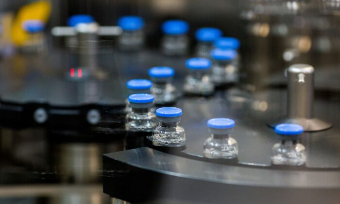 Vials of investigational COVID-19 treatment drug remdesivir are capped at a Gilead Sciences facility in La Verne, Calif., on March 18, 2020. (Gilead Sciences via Reuters)