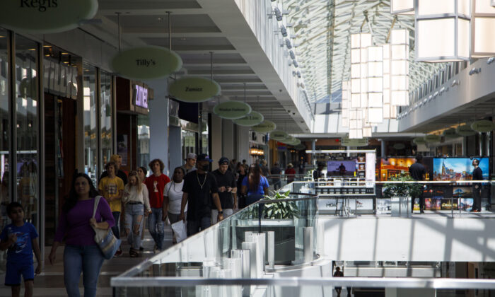 Customers make their way through CoolSprings Galleria shopping mall despite many retail locations inside the mall remaining closed on May 2, 2020 in Franklin, Tenn. (Brett Carlsen/Getty Images)