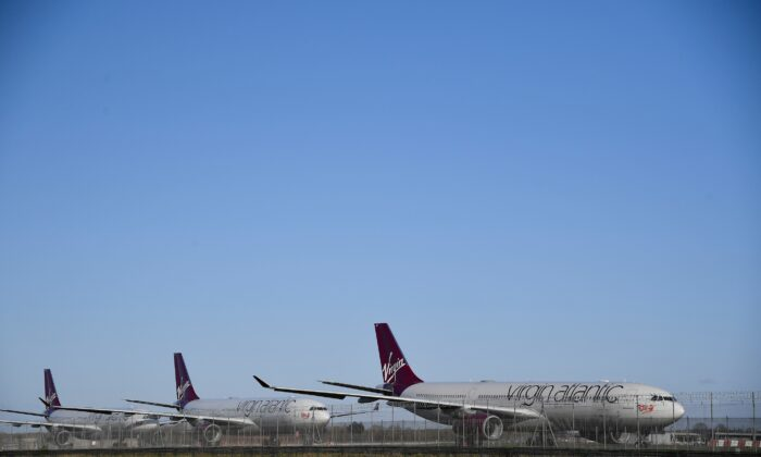 Virgin Atlantic planes are seen at Heathrow airport as the spread of COVID-19 continues, London, UK, March 31, 2020. (Toby Melville/Reuters)