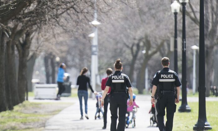 Police officers patrol a city park in Montreal on May 3, 2020, as the COVID-19 pandemic continues. (Graham Hughes/The Canadian Press)
