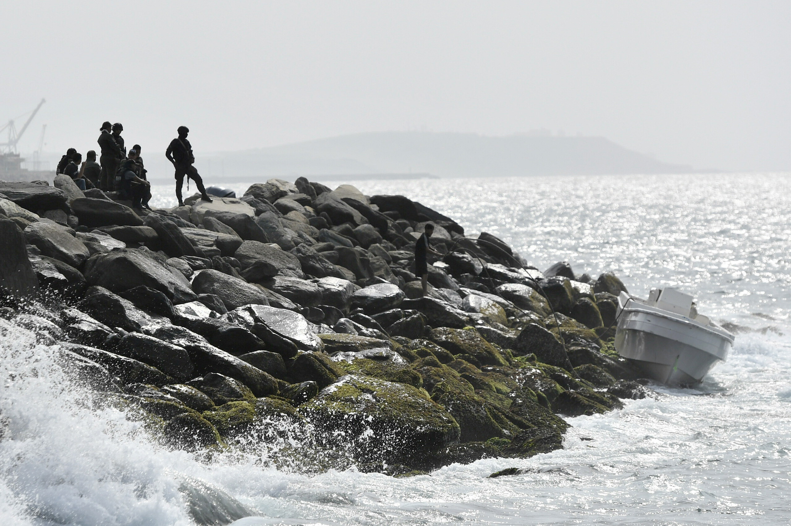 Security forces guard the shore area and a boat