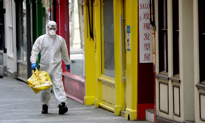 A man wears full protective equipment to protect against the CCP virus as he shops in London on May 4, 2020. (Kirsty Wigglesworth /AP Photo)
