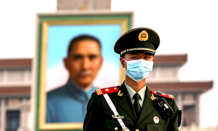A Chinese police wearing protective masks  march in front of the portrait of Nationalist founder Sun Yat-sen at Tiananmen Square in Beijing, China, on April 28, 2020. (Lintao Zhang/Getty Images)