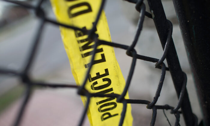 File photo: remnants of crime scene tape remain on a fence. (Scott Olson/Getty Images)