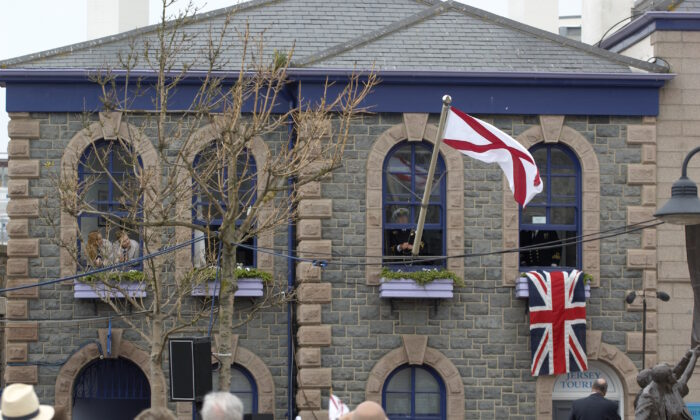 Reenactment of the raising of the flag, Liberation Day in Jersey, file photo. (Jersey Tourism/CC BY 2.0)