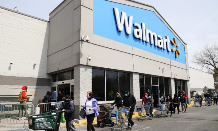 People wear masks and gloves as they wait to enter a Walmart in Uniondale, N.Y., on April 17, 2020. (Al Bello/Getty Images)