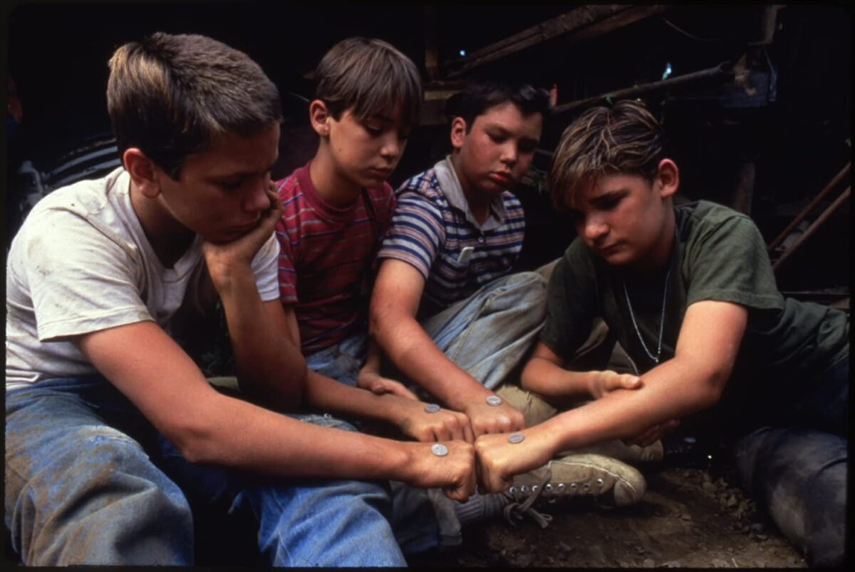 """Four boys bump fists in """"Stand By Me"""""""