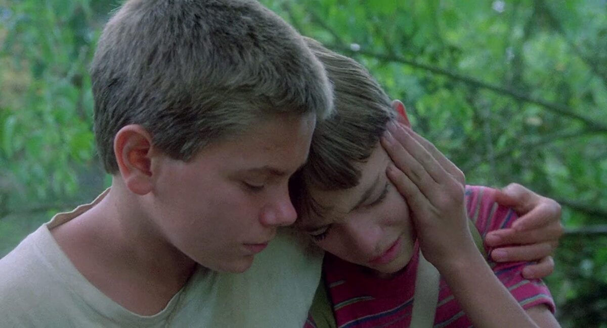 """two boys have a hug in """"Stand By Me"""""""