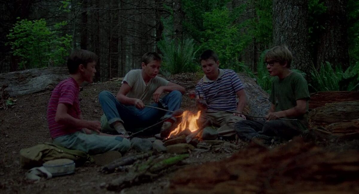 """four boys around a campfire in """"Stand By Me"""""""