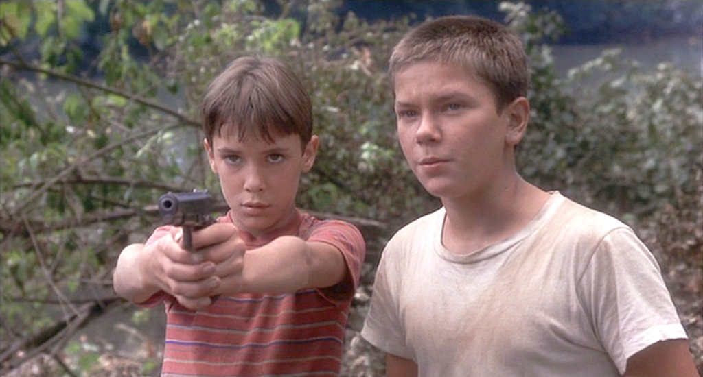 """two boys, on holding gun, in """"Stand By Me"""""""