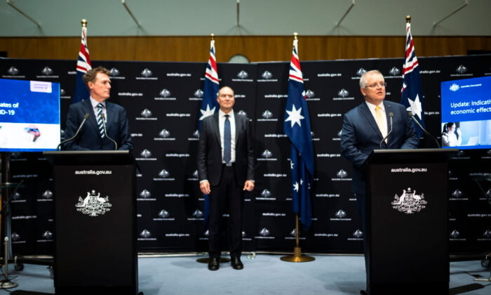 Australian Prime Minister Scott Morrison (R) speaks at a press conference alongside Australian Attorney-General Christian Porter (L) and Head of the National COVID-19 Coordination Commission Nev Power (C) at Parliament House on May 5, 2020 in Canberra, Australia. (Rohan Thomson/Getty Images)