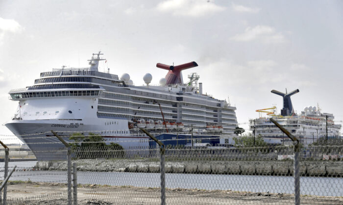 Carnival Cruise ships are docked at the Port of Tampa, in Tampa, Fla. on March 26, 2020. (AP Photo/Chris O'Meara)