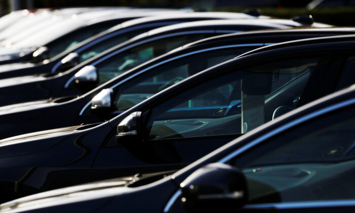 Cars are displayed outside a Volvo showroom in west London on Oct. 4, 2013. (Luke MacGregor/File Photo/Reuters)