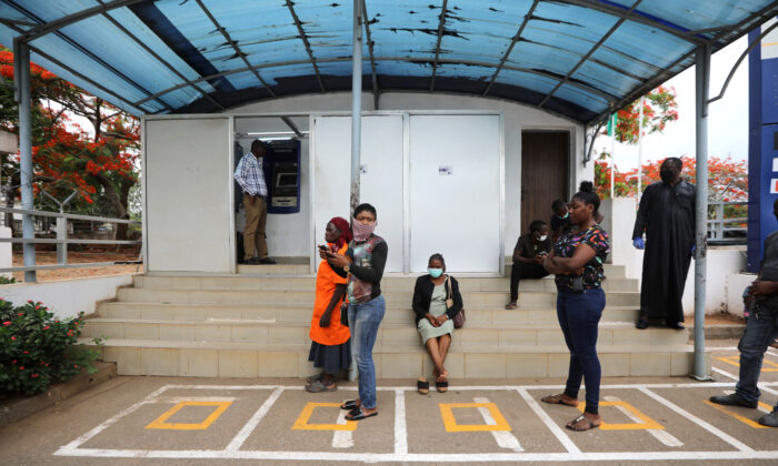 People wait within markings to use the automated teller machine (ATM), as authorities ease the lockdown following the coronavirus disease (COVID-19) outbreak, in Abuja, Nigeria May 4, 2020. (Afolabi Sotunde/Reuters)