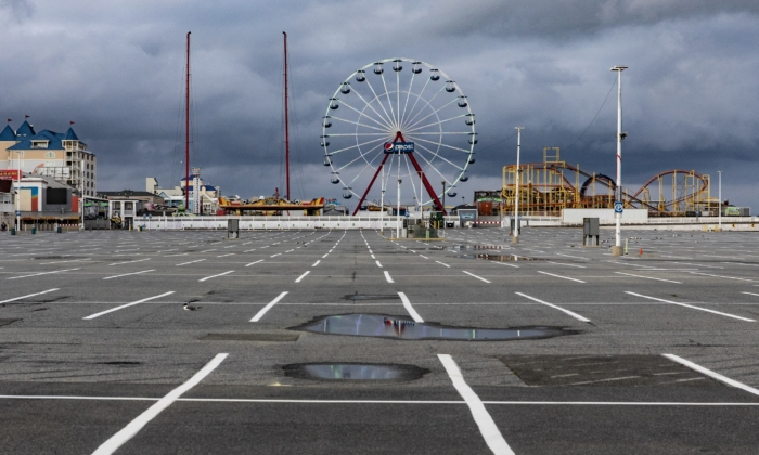 The parking lot and rides of Jolly Roger at the Pier remain empty and silent in Ocean City, Md., on April 26, 2020. (Samuel Corum/Getty Images)