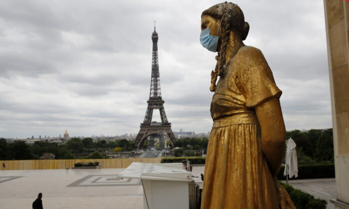 A statue wears a mask along Trocadero square close to the Eiffel Tower in Paris, France, on May 4, 2020. (Christophe Ena/AP Photo)