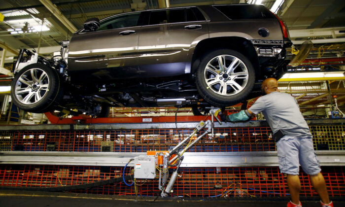 Mike Guillen works on the assembly line at the General Motors Assembly Plant in Arlington, Texas, on June 9, 2015. (Mike Stone/Reuters)
