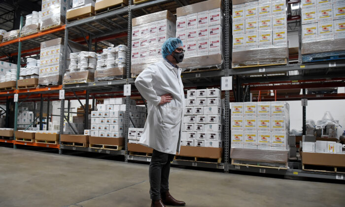 Chief Executive Officer at PastryStar Antonin Picou wears a face mask at a PastryStar warehouse in Laurel, Maryland, on May 4, 2020. PastryStar's factory has been repurposed to produce hand sanitizer. (Olivier Douliery/AFP via Getty Images)