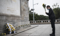Chinese Police Threaten Virus Victim's Son Over Efforts to Build Memorial
