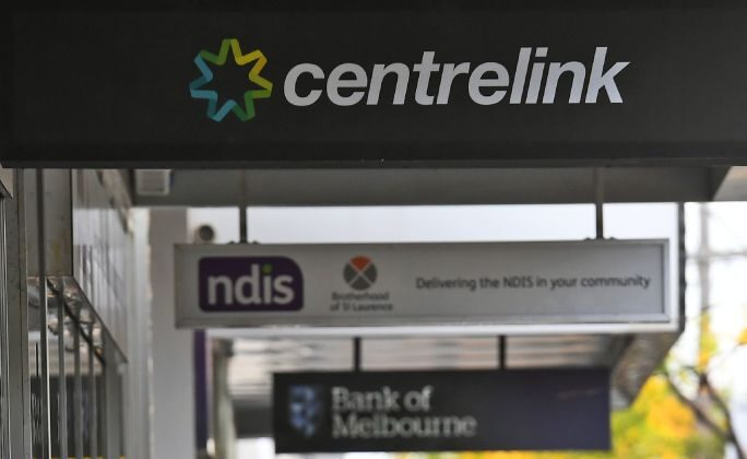 People queue up outside a Centrelink office in Melbourne for government payments on April 20, 2020. (Willian West/AFP via Getty Images)