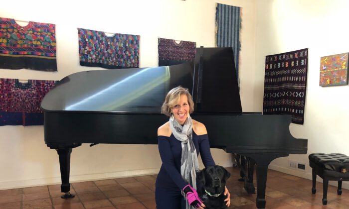 Professional pianist Lisa Spector with her black Labrador retriever, Gina. (Courtesy of Farha Akhtar)
