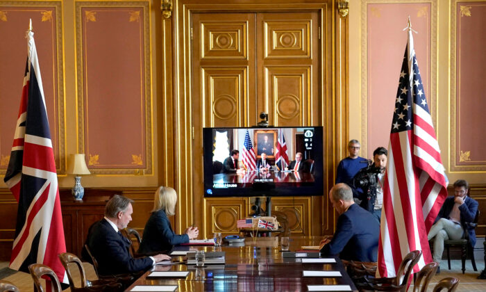 Britain's International Trade Secretary Liz Truss talks remotely from the Foreign Office to the U.S. Trade Representative Robert Lighthizer to begin negotiations for a trade agreement, in London on May 5, 2020. (Andrew Parsons/10 Downing Street/Handout via Reuters)
