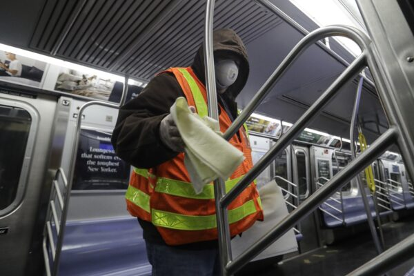 MTA officials work on trains for the disinfecting operations