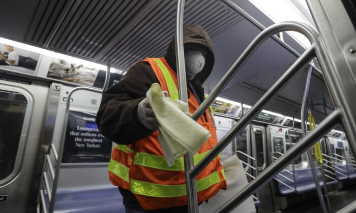 MTA officials work on trains for the disinfecting operations at the Coney Island Stillwell Avenue Terminal Wed., May 6, 2020, in the Brooklyn borough of New York. (Frank Franklin II/AP)