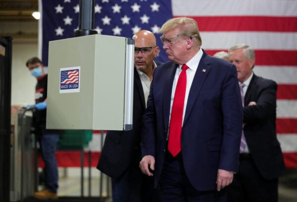 President Donald Trump tours face mask production facility in Phoenix, Arizona
